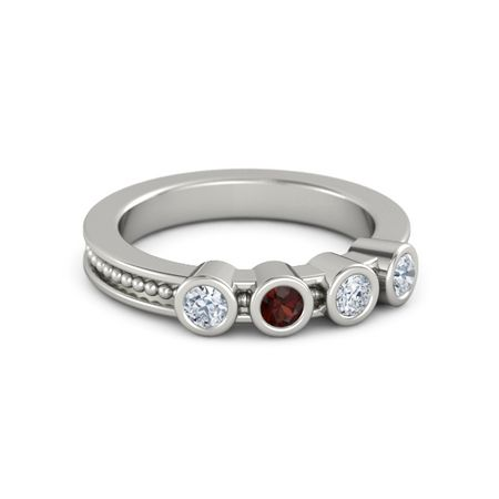 A Mother's Gift Ring With Four Gems